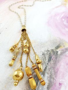 """A Bigger Story"" - 1960's vintage gold and rhinestone beaded tassel on iridescent glass beaded chain"