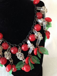 http://www.ebay.com/itm/Vtg-Bakelite-Red-Cherry-Massive-Necklace-with-Lucite-Bow-Leaves-JAN-CARLIN-/261846718402?pt=LH_DefaultDomain_0