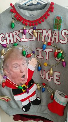 The Donald says Christmas is Uge! 36 Mini LED Battery powered lights! (Takes 3 AA batteries, not included) Size: Mens Medium Sweatshirt! Shown on Womens Medium mannequin) I would say a Ladies Large  This novelty sweater is AWESOME!!! 36 Multi color LED lights included (batteries are not)  For All of my novelty sweaters everything is attached using quality Hot Glue. CARE of your Sweater: Your sweater cannot be washed. You may spot clean areas carefully. If your sweater includes lights, they…