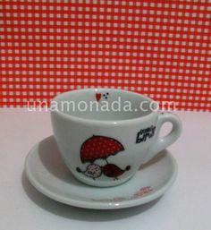 Taza de té con plato de pajaritos