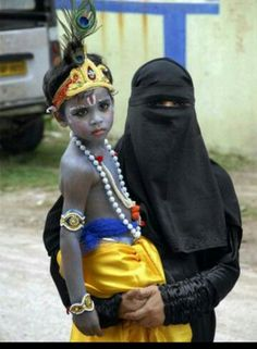 A muslim woman taking her son dressed as lord krishna.. Sree krishna jayanthi fancy dress You will find this only in India...mera bharat mahan..truely google.com