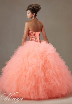 Quinceanera Dress Vizcaya Morilee 89072 Jeweled beading on a Ruffled tulle ball gown Colors: Coral burst, Pink panther, scuba blue and white A back side view