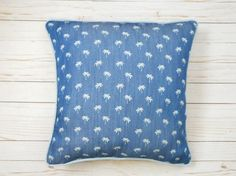 Accentuate your home with the laid back style of this denim print pillow. Invite a tropical vibe into any room. The front side of the pillow cover is a sweet repeat palm tree print. The palm trees are bleached from the fabric rather than printed. The piping and back side of the pillowcase is a blue linen that matches the color of the palm trees. Closes with a zipper hidden behind the piping. Listing is for the cover only and does not include the insert. 2 sizes are available. Thank you so…