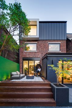 Post Architecture has added rectilinear dormers to the facades of a century-old brick house as part of a major renovation of the urban residence.
