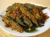 Gujarati stuffed okra with its origins in Tarla Dalal's recipe for a Gujarati stuffed bhindi is simply out of the world. Give it up for some okra, Bhindi Sambhariya. Andhra Recipes, Gujarati Recipes, Indian Food Recipes, Gujarati Food, Okra Recipes, Cooking Recipes, Cooking Blogs, Dishes Recipes, Recipies
