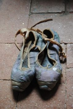 Very old and very beautiful ballet shoes.