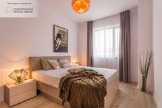 A warm hygge feeling | Bedroom in a 3-room apartment furnished and accessorized by our SDH team of interior designers