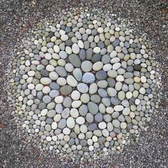 Gorgeous organized chaos rock mandala by #dianalynnthompson #brooklynrocksfind…