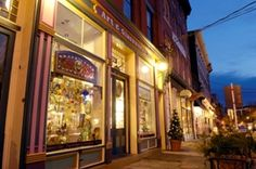Miss living here sometimes...  Downtown Lancaster, PA at night. Beautiful storefronts!