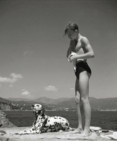 A man and his dalmation enjoy a day at the beach, 1936. ph. by Herbert List