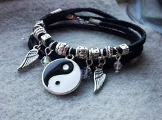 """Super cute one of a kind handmade ying yang necklace. Hippie chic style for summer! made with tibetian charms swarovski crystal and chez glass. 28"""" can also be worn as a necklace"""