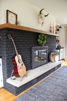 Our Black Painted Fireplace, Black Brick Fireplace, Black Fireplace www.BrightGreenDoor.com