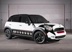 How cool! A mini Cooper, painted to resemble Paul Stanley, from Kiss! LOVE IT!