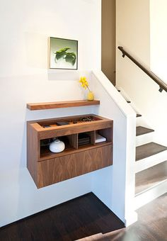 A more modern wall-mounted table has a recessed space on top that acts as a sort of built-in bowl for keys and wallets.