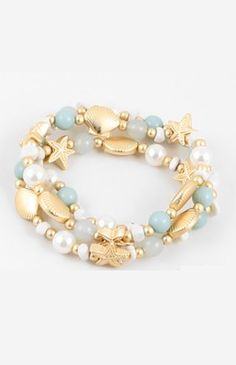 Beach ready with this mint and gold stretchy starfish bracelet. Shop now at cinnaryn.com.