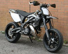 "A 500cc 2-stroke supermoto?!?! Batman approves. Who wants to tame this beast?? Honda CR 500 ""Black Diamond"" by Taffy Racing"
