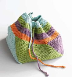 This crocheted bag pattern with all the colors is really pleasant looking and eye catching. Swirling Bag by Kathy Merrick has so many purposes: it's great as a crochet or knitting tools bag or a jewelry bag. You can also use it as a bag to hold a gift or a makeup bag. Make several …