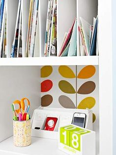 Mail slot-- one for each family member-- hold magazines, homework, bills, and more. Use a router to make grooves in the shelves, then insert vertical dividers. A compact charger station keeps devices charged and ready to go. An outlet is installed in the wall nearby.