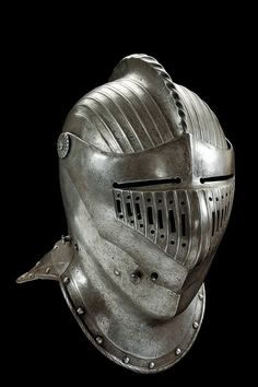 A closed helmet in the late XVI Century style Police need some sort of head gear protecting their heads & necks while not restricting movement.