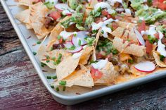 These barbecue nachos are made with all your favorite fixings on a cookie sheet for easy making and easy, delicious eating!
