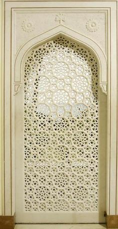 Cream colored 'punctured' door. (This reminds me of lace.)