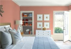 Look at the paint color combination I created with Benjamin Moore. Via @benjamin_moore. Wall: Smoked Salmon CC-154; Trim: Wind's Breath OC-24; Bookcase Back Wall: Silhouette AF-655; Ceiling: White Heron OC-57.