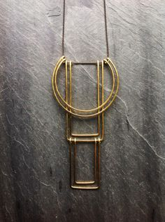 Geometric Totem Necklace - By Loop Jewelry- Hammered Brass Geometric Necklace-Hammered Sterling Silver Geometric-Art Deco-Portland Jewelry by LoopHandmadeJewelry on Etsy https://www.etsy.com/listing/222205044/geometric-totem-necklace-by-loop-jewelry