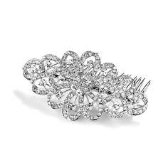 Bridal Prom Hair Comb Dazzling Crystal Swirls Sparkling crystal bridal hair comb is 4 inches wide by 2 1/4 inches tall. Bold wedding headpiece is plated in antique silver rhodium and is the ideal hair accessory to adorn wedding, prom, homecoming and pageant hairstyles with 100's of sparkling crystals.