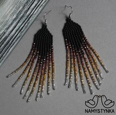 These gold handmade earrings are made of high-quality Czech beads and strong synthetic thread. They are elegant, fashionable, and highly versatile, suitable for everyday wear. Features: Sterling silver components Color: gold, silver, black. This item is currently in stock. You must be