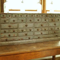 .drawers of multi sizes with old paint, heaven