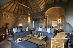 A collection of extraordinary life experiences made possible by a family of remarkable people Home Living Room, Living Room Decor, Boutiques, Resorts, Resort Plan, Modern Lodge, Game Lodge, Interior Design Work, Lounge Areas