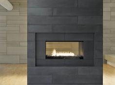Paloform modern concrete tiles for walls and fire places   Shown in Charcoal   Designed and made in Canada   Shipped everywhere   UK Europe North America.