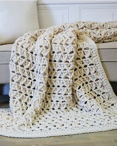 Super-chunky blankets in neutral colors ooze luxury and comfort and are the ultimate in cold-weather coziness! This throw is a crochet take on that modern look, with a faux cable stitch that makes it as quick as can be!