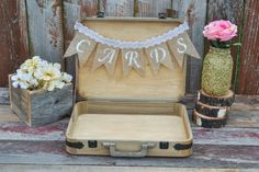 "These rustic card trunk with burlap flower and wood slice accents make the perfect edition to any rustic wedding, woodland baby shower or any other fun outdoor event.  This listing is for 1 rustic wood trunk with  burlap and lace cards banner. Painted or stained to the color of your choice. It is 15 3/4"" by 12"" and bottom is 2"" deep and top is 1"" deep. It will hold approximately 100 to 125."