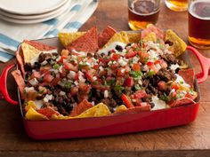 Super Nachos : Make Rachael's supersized nachos with homemade cheese sauce, beans, spiced beef and pico de gallo salsa for a quick, snack-able supper.