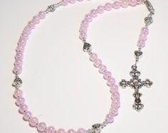 This beautiful Catholic Rosary is handmade with red glass beads and silver lined clear seed beads. The cross and medallion are antique silver-finished pewter.  Gift them for your Baptisms, First Holy Communion, Confirmations, Wedding party, or just a lovely gift for loved ones. I am happy to create a custom design just for you...please message me with your specifications. Custom orders are always welcome!  Dimensions: Main necklace: 18 inches Drop and crucifix: 4-5 inches Bead Type: Glass…