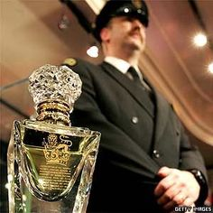 A 500 ml bottle of the world's most expensive perfume - Imperial Majesty - it has a five-carat diamond-18-carat gold collar - not many perfumes get a guard to stand by them