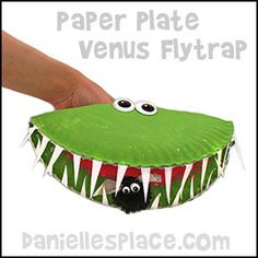 Venus Flytrap Paper Plate Puppet Craft with pompom fly from www.daniellesplace.com