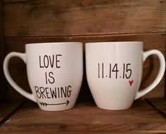 Want to get a unique wedding or anniversary gift? These handwritten personalized his and her mugs make the perfect keepsake gift. Personalize the mugs with the important date. :::::ITEM DESCRIPTION:::::  • This listing is for two handwritten coffee mugs • Capacity: 16 oz.  • Mugs are hand drawn and made to order. Picture above is an example of what yours will look like. Please allow for slight variations. • Gently hand wash with warm water and refrain from scrubbing over the design in order…