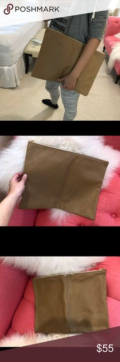 Oversized American Apparel Leather Pouch/Clutch Never used. 100% leather. Always classic and never out of date. Camel color. Can be easily matched anything. perfect to put a 15 inch laptop or some stationery folders inside and there is still room.  I Just kept this one in my closet. Looks like brand new except I fold it for storage so there is a line in the middle. This can be easy repaired by putting some clothes inside the clutch for one or two days to support its shape.  Retail price: $80…