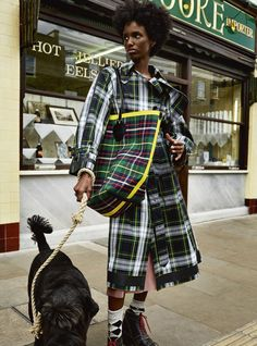 Clashing tartan outerwear with The Giant from the Burberry September 2017 collection in the November issue of Harper's Bazaar UK, photographed in London