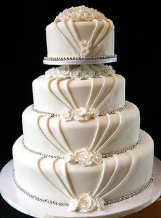 Elegant Wedding Cake with Roses and Silver Accents