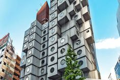 "Thanks to ""the world's largest community-driven hospitality company,"" a.k.a Airbnb, we can now rent a cube-like apartment in Tokyo's historical Nakagin Capsule Tower (NCT). For $75 a night, you can stay at this modular mega structure, a rare example of Japanese Metabolism architecture  designed by Kisho Kurokawa in the early 1970s. The rental includes a hyper compact bedroom en suite, space-saving furniture, as well as a circular-framed city-view."