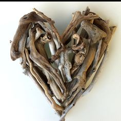 """""""Driftwood Heart"""" Driftwood Art by Mother Nature.    Handmade by Doctor Driftwood.  Made out of """"all natural"""" handpicked driftwood and stones """"reclaimed"""" from California. """"Where Nature and Style Meet.""""  Follow me at Facebook/DoctorDriftwood and Pinterest/DoctorDriftwood.  Look for me on Flickr/DoctorDriftwood.  Visit DoctorDriftwood.com for sales, more info, and harmony.  Enjoy Nature in your home.  Cheers!"""