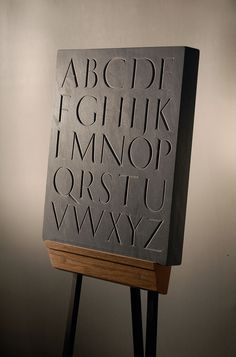 hand carved letters in stone, carved in slate marble limestone, slate plaques, slate house plaques, slate gravestones, slate address plaques, slate signs