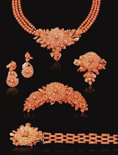 CARVED CORAL PARURE, MID 19TH CENTURY. Comprising: a necklace, a bracelet, a brooch, a pair of pendent earrings and a hair ornament; each highlighted by a principal carved coral flower head within frames of carved coral branches, fruits, buds and flowers