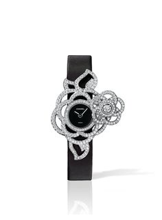 Chanel | 18K white gold and diamonds.  Black satin strap.  High precision quartz movement.