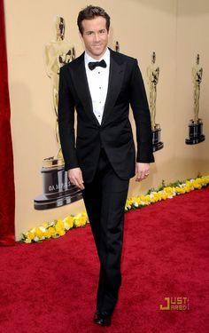 Ryan Reynolds in black TOM FORD Windsor tuxedo w/Grosgrain silk peak lapels and jetted pockets. White plain front evening shirt w/spread collar and black onyx studs. Black Grosgrain silk bowtie.
