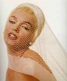 Marilyn wearing pearl earrings