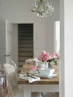 pretty dining room {love the chandelier}...this could be my dining room...stairway and all! :)